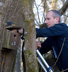 Prof Jon Blount inspecting a bird box