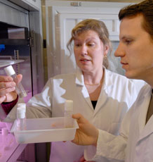Professor  Nina Wedell with Dr Tom Price in the lab